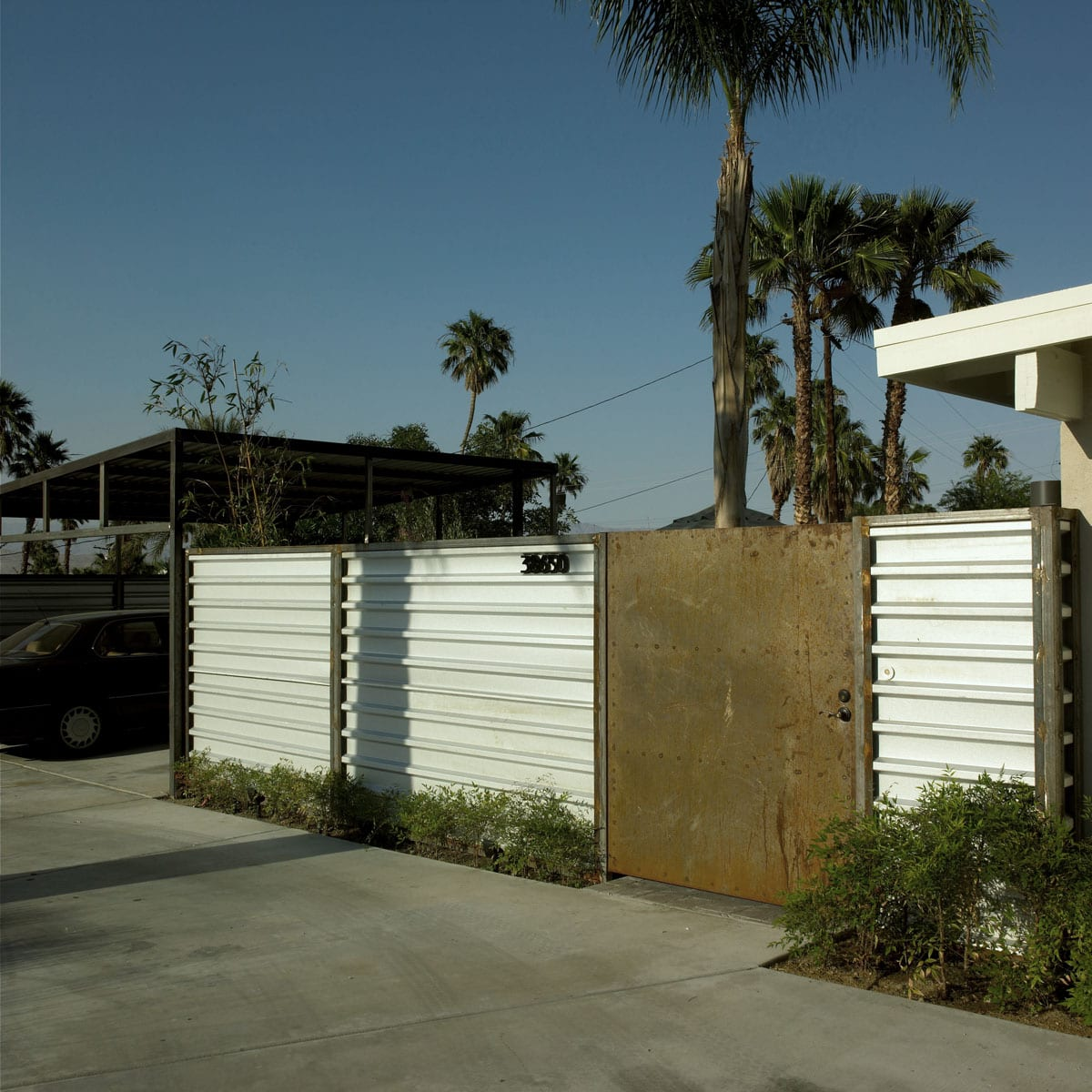 Rusted Steel and Galvinized Metal Fence Carport